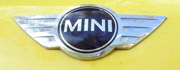 Logo for Mini. Mini Spray Paint Are Sold By Paint Scratch.
