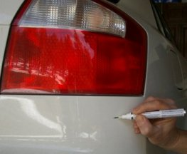 Apply touch up paint to the paint scratch.