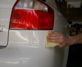 Use rubbing compound to polish the repaired paint scratch.